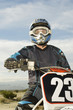 Motocross racer on bike in desert, portrait