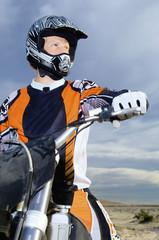 Motocross racer on bike in desert