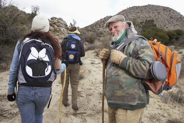 Family hiking in desert, portrait