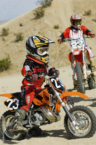 Young motocross racer in desert