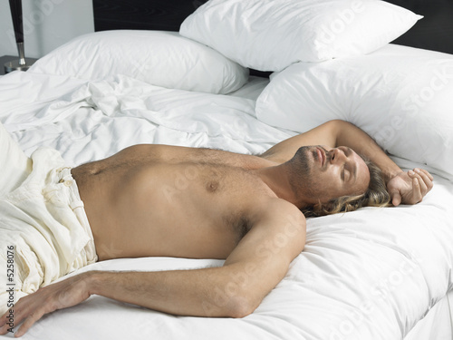Man Asleep on Bed