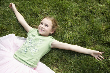 Smiling Girl Lying in the Grass