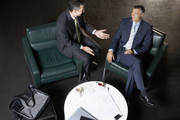 Businessmen Talking During Meeting