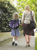 Mother Walking Daughter Home From School