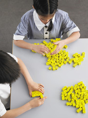 Schoolkids Playing with Dice