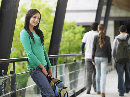 Young Woman Leaning Against a Railing