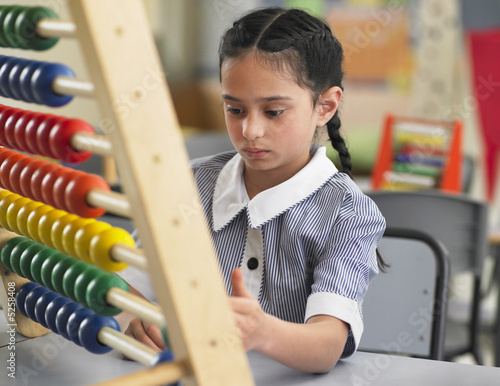 Schoolgirl Using an Abacus