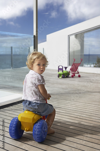Boy Playing on Porch