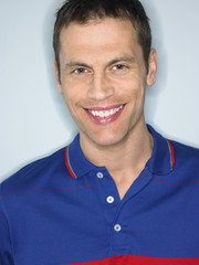 Man smiling in studio head and shoulders