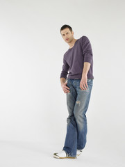 Man posing in studio full length