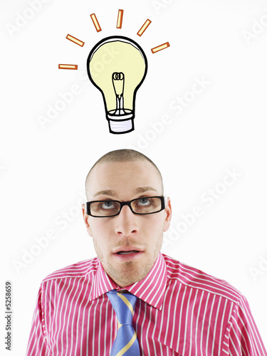 Man in glasses looking up, head and shoulders, below illustrated light bulb