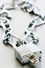 Padlock with key and chain