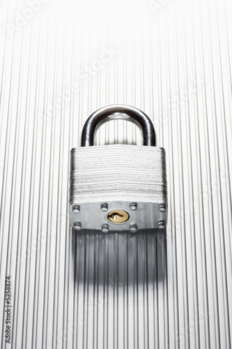 Padlock on metal surface