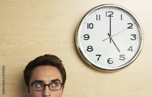 Businessman Looking at Clock