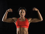 Woman flexing muscles. poster
