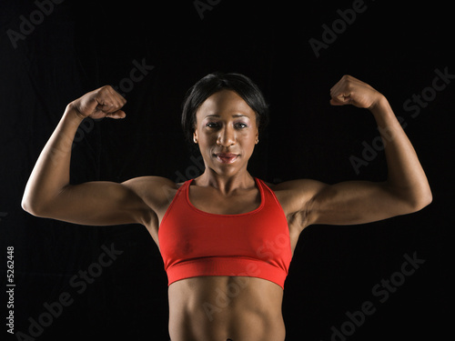 Woman flexing muscles.