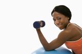 Woman lifting dumbbell. poster
