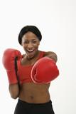 Woman boxer punching. poster