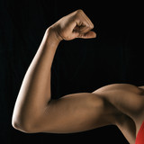 Strong female bicep flexing. poster