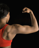 Woman flexing bicep. poster