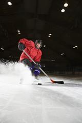 Woman playing hockey.