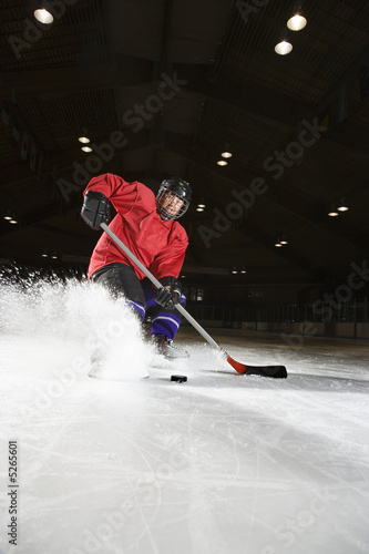 Woman playing hockey.