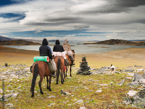 Horseriders in mongolian wildernesss