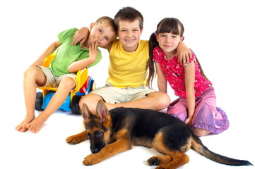 Children with young dog