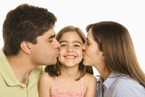 Parents kissing daughter. poster