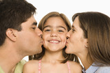 Parents kissing girl. poster