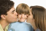 Parents kissing son. poster