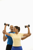 Woman and man exercising. poster