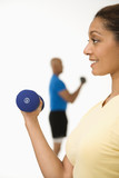 Woman exercising with dumbbell. poster