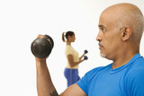 Man exercising with dumbbell. poster