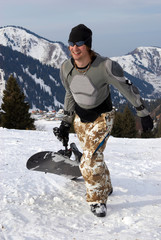 Snowboarder in defense on ski resort slope