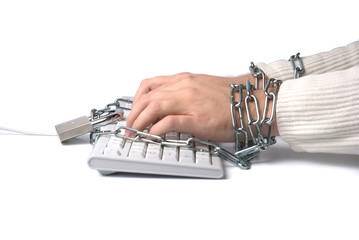 Hands chained to keyboard