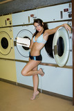 Sexy woman in Laundromat