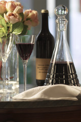 red wine iin crystal bottle and glasses