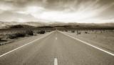 Empty californian highway through the desert poster