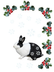 Cute bunny with holly berries