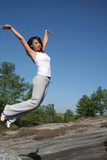Asian woman jumping for joy poster