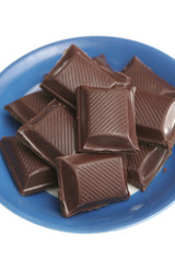 It is a lot of segments of chocolate lay on a plate