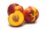 three fresh nectarines on white background