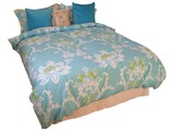 A Double Bed with a Colourful Quilt Cover. poster
