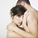 Young couple in embrace poster