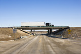 Tractor trailer truck on overpass. poster