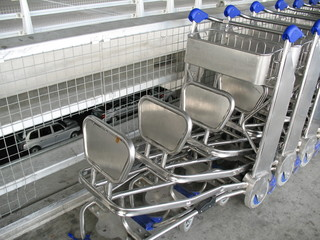 Rows of trolleys at the airport