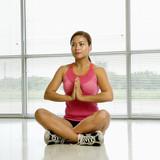 Woman in lotus posture. poster