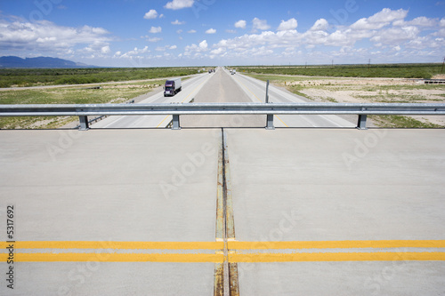 poster of Overpass with highway below with tractor trailer truck.
