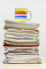 Coffee Mug on Stack of Files